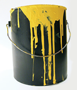 Paint tin with paint dripping down the side